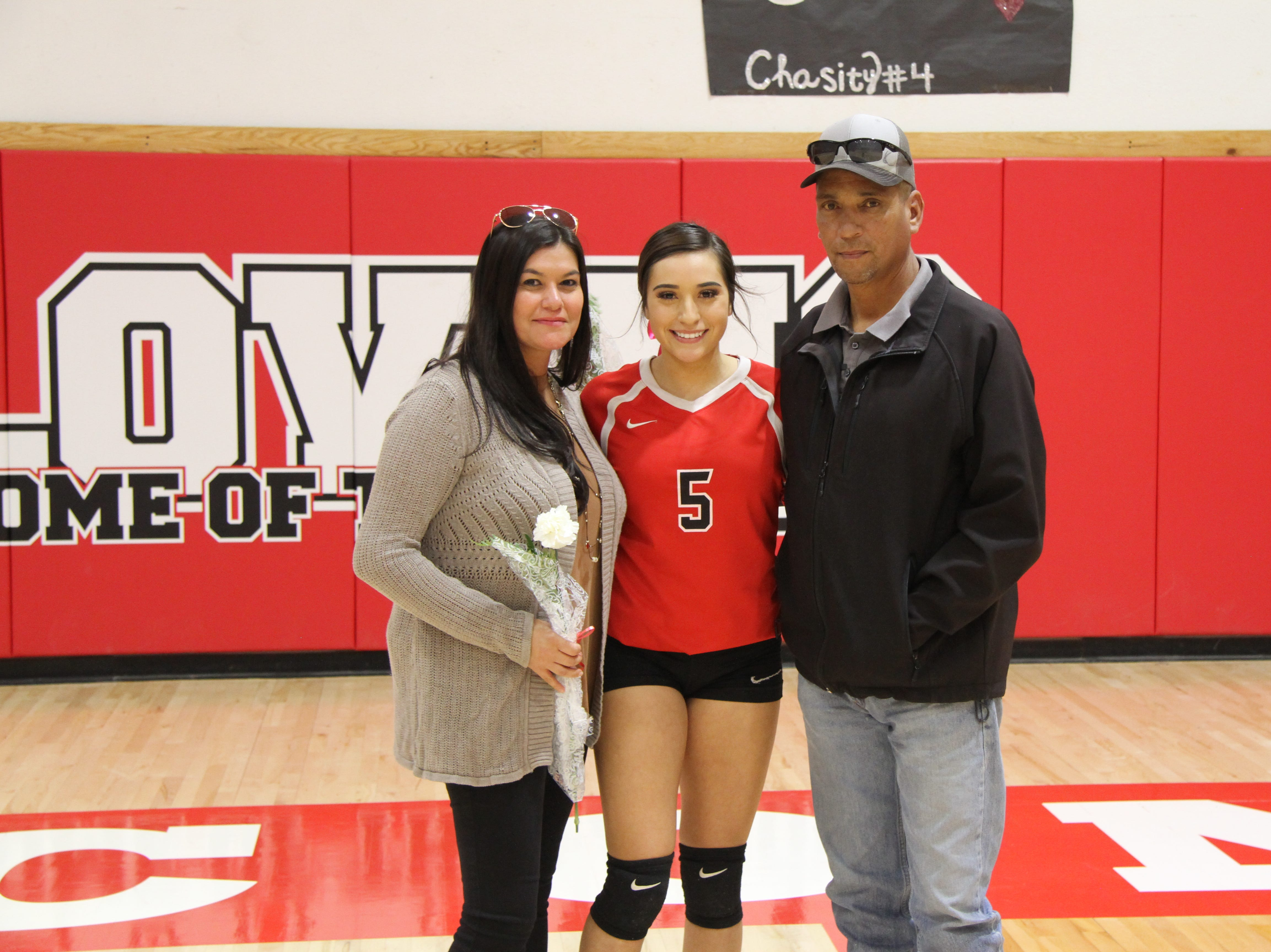 Anyssa Rodriguez and her family pose after Thursday's match against Eunice. Loving won in four sets.