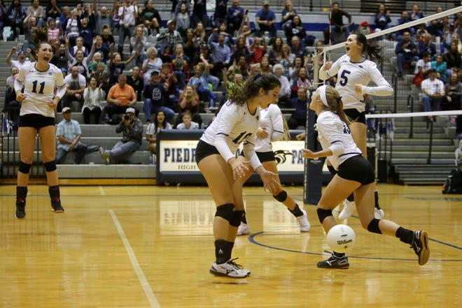 Piedra Vista celebrates its match-winning point against Farmington during Thursday's District 2-5A match at Jerry A. Conner Fieldhouse in Farmington. Visit daily-times.com to see video highlights and additional photos.