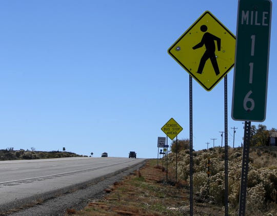 A sign at mile marker 116 on U.S. Highway 550 near Nageezi warns drivers to watch for pedestrians.