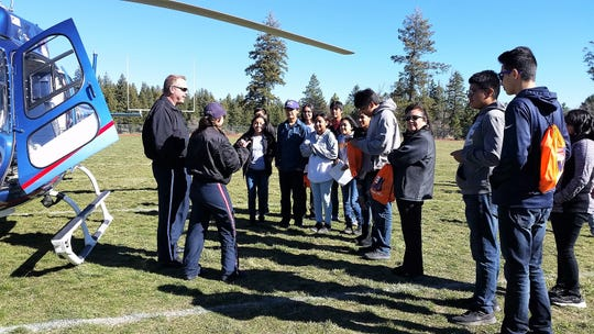 Mescalero Apache schools staged a career fair for the high school and an emergency airlift from Alamogordo landed in the football field. The crew talked to students about the opportunity for a career as emergency technicians.