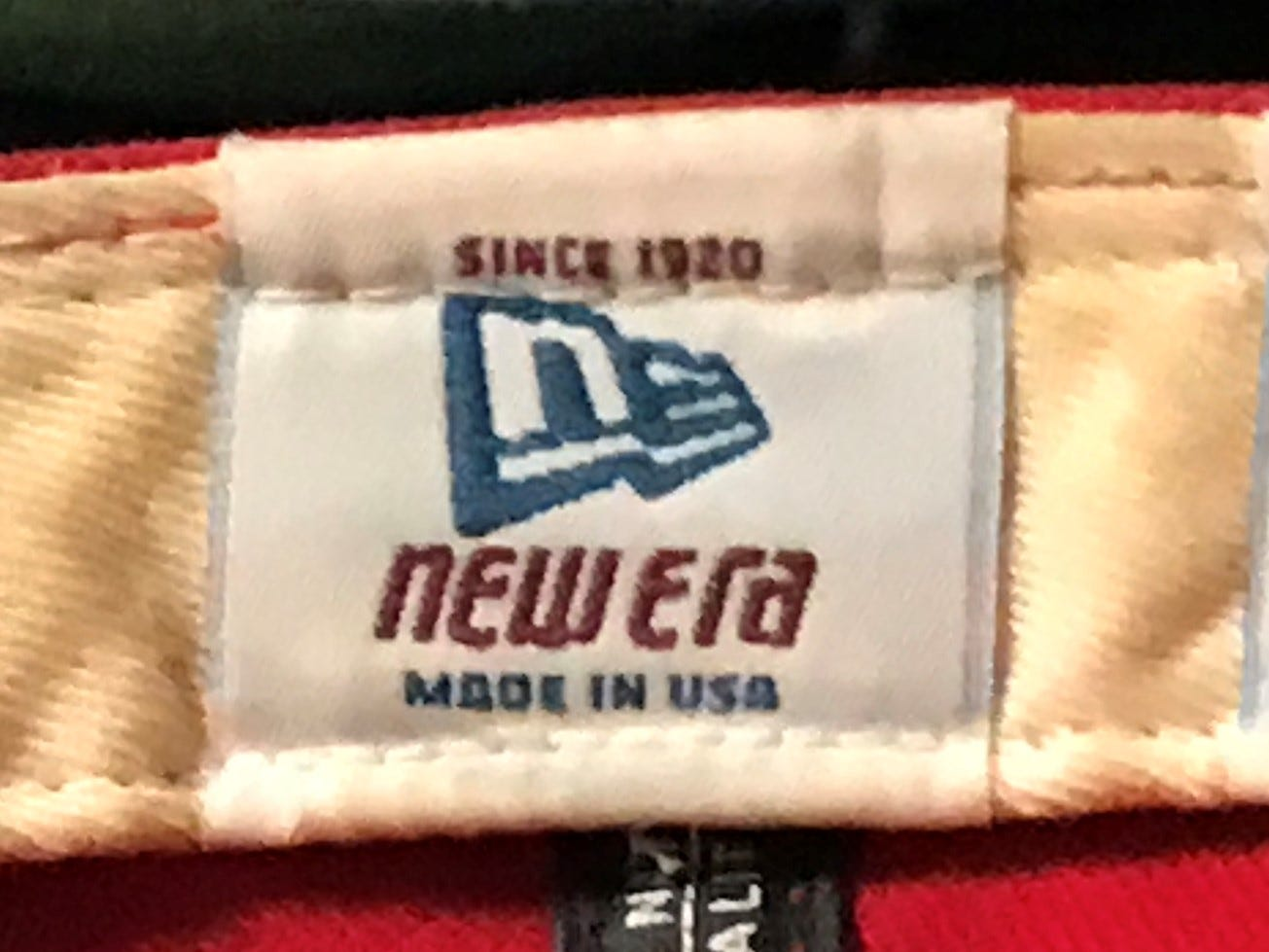 Eugene McDonald's Cincinnati Reds baseball cap was made by New Era, a company in business since 1920 -- the same year McDonald was born.