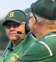 John Herrington (left) is the only head coach in Farmington Harrison's esteemed 49-year football history