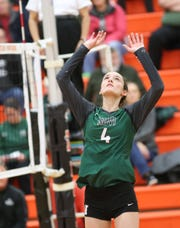 Novi's junior setter Shannon Jennings makes the pass in the Division 1-District 20 championship final.