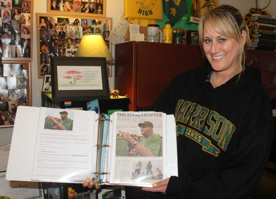 Longtime Harrison counselor Amy Proctor is chronicling the football program's final years for highly-regarded head coach John Herrington with a series of scrap books.