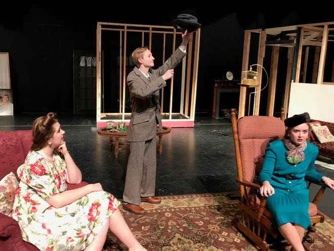 """Elwood P. Dowd (Nick Smathers), with his 6-foot-tall invisible friend Harvey, talks to Myrtle May Simmons (Ava Unti, right) and Veta Louise Simmons (Marina McMahon in South Lyon High School's production of """"Harvey."""""""