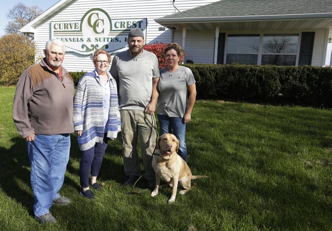 Dave and Bev Juedes, Matt Mokler, Lisa Bowen and Gunner pose in front of Curve Crest Kennels & Suites, 414 State 26, on Wednesday, Oct. 31, 2018. Mokler and Bowen bought the Nekimi business from the Juedes in June.