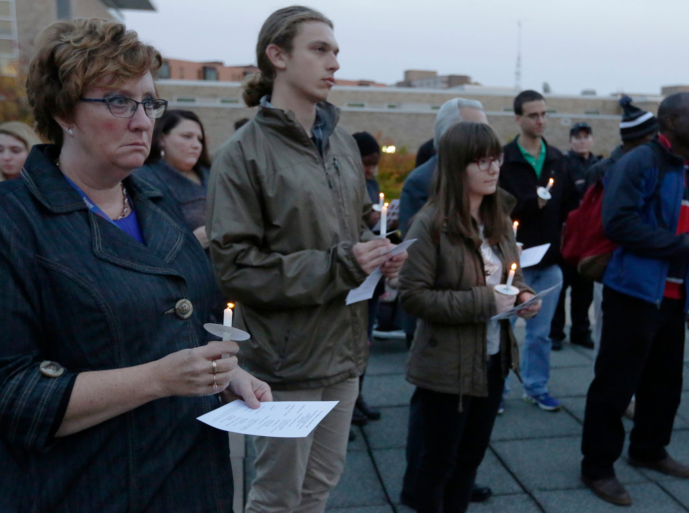 A candlelight vigil was held on the upper deck of UW-Oshkosh's Albee Hall Thursday, November 1, 2018, to come together and remember those killed at the Tree of Life Congregation in the Squirrel Hill neighborhood of Pittsburgh, Pa. Eleven people were killed and six injured in the attack.