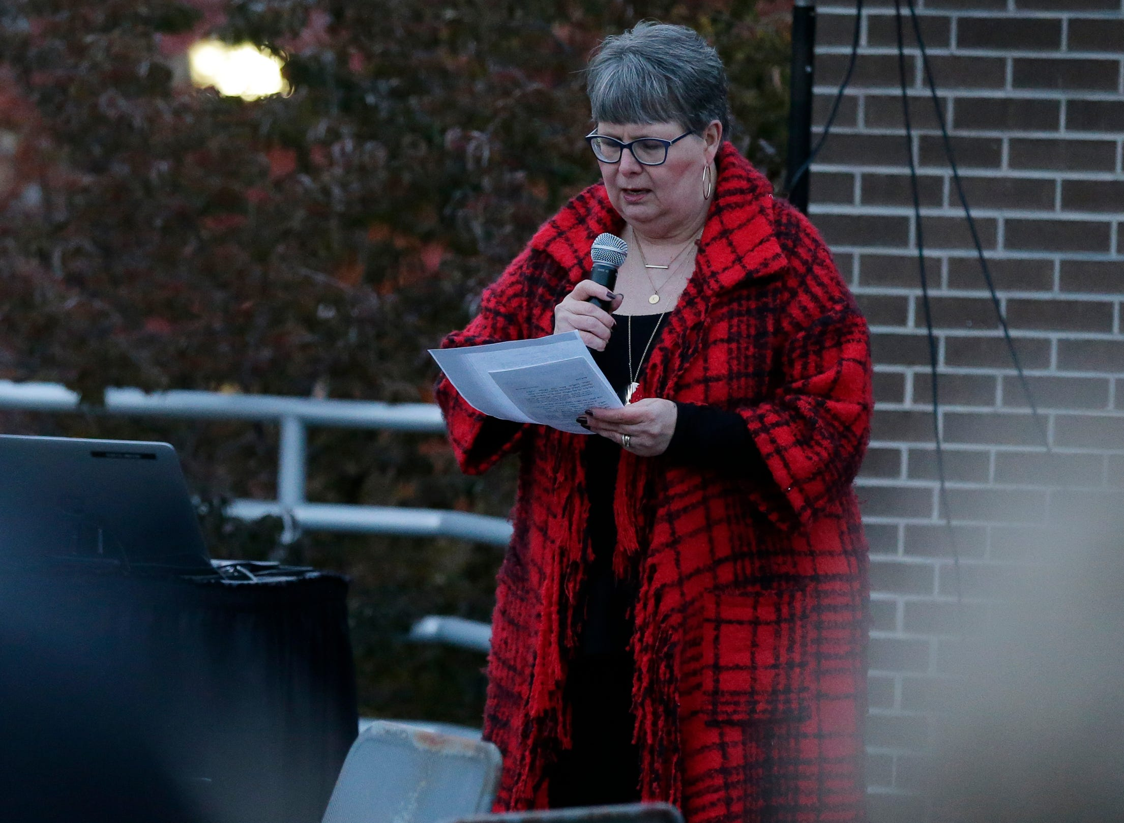 Dr. Kathleen Corley Schuhart, Prof. New Testament and Christianity gives the readings.  A candlelight vigil was held on the upper deck of UW-Oshkosh's Albee Hall Thursday, November 1, 2018, to come together and remember those killed at the Tree of Life Congregation in the Squirrel Hill neighborhood of Pittsburgh, Pa. Eleven people were killed and six injured in the attack.