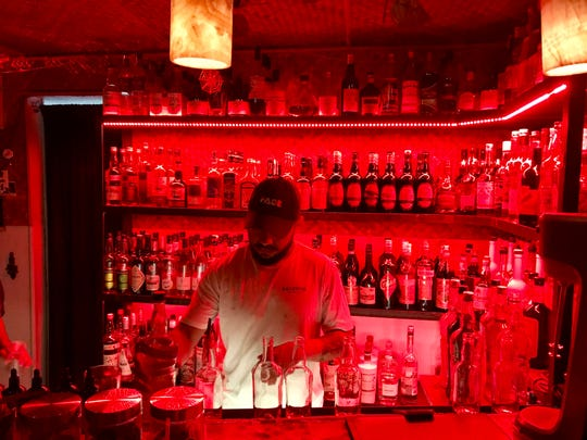 Barback Pablo Hernandez makes a drink at Bootlegger Tiki on Thursday, Nov. 1.