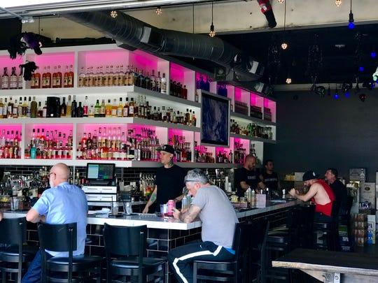 People enjoy drinks at Blackbook Bar on Thursday, Nov. 1.