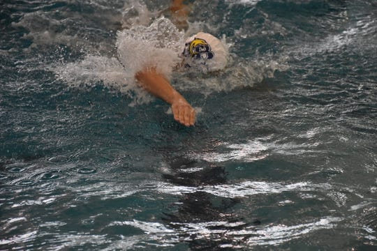 Gulf Breeze senior Cali Wilson churns through the water on the anchor leg of the Dolphins' winning 400 freestyle relay team.