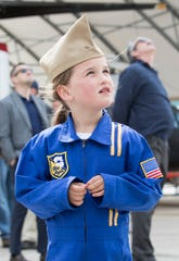 Wearing her Blue Angels flight suit, Ansley Devries, 5, of Gulf Breeze looks skyward Friday during the Blue Angels Homecoming Show at Naval Air Station Pensacola. Devries hopes to one day become a Blue Angels pilot.