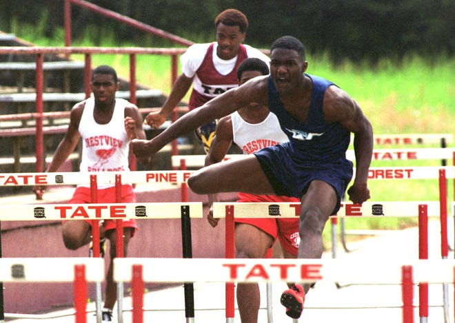 Woodham Justin Gatlin head  over the hurdles during the finals of the 110 meter event   to win  in 13-95 second at the Subway Relays on Saturday Tate High School.