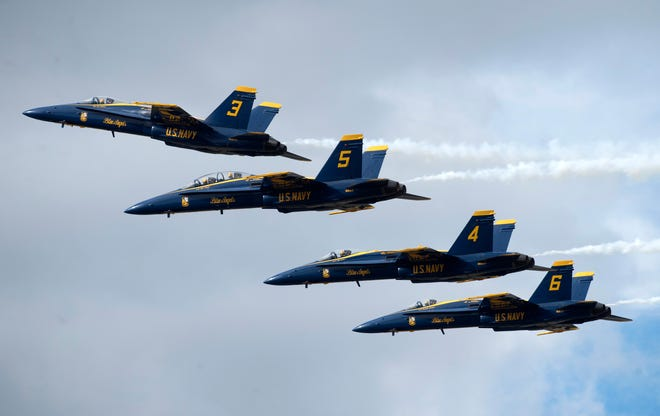 The U.S. Navy Blue Angels flight demonstration squadron takes to the skies Friday over Naval Air Station Pensacola during the team's annual Homecoming Air Show.
