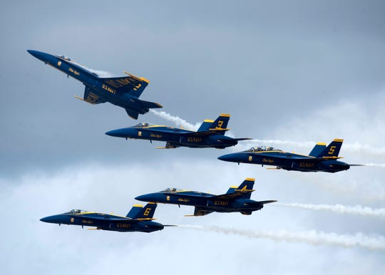 The U.S. Navy Blue Angels flight demonstration squadron takes to the skies over Naval Air Station Pensacola during the team's annual homecoming air show in November.
