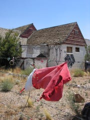 A few strands of tinsel and a tattered stocking hang on the barbed wire fence around the gutted and long-abandoned buildings of Santa Claus.