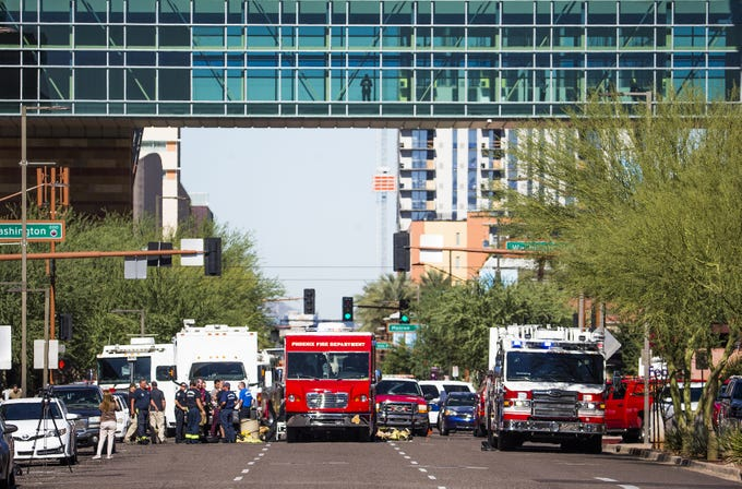 Phoenix firefighters and emergency personnel respond Nov. 2, 2018, to reports of a white powder substance found in the Collier Center, 201 E. Washington St., in downtown Phoenix.  This view is looking north on Third Street at Washington.