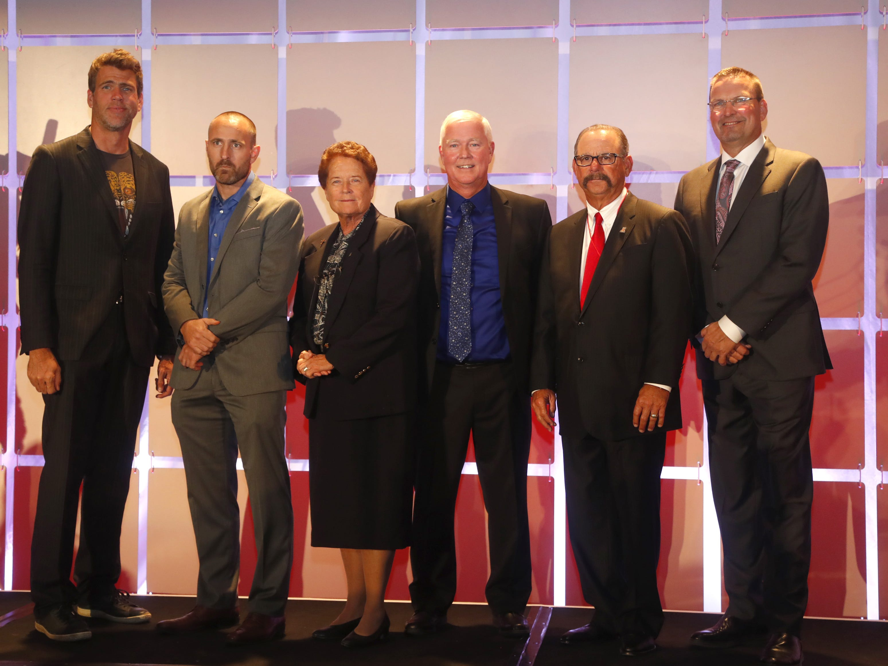 The 2018 Arizona Sports Hall of Fame inductees Gary Hall Jr. (L-R), Kevin Tillman representing is brother Pat Tillman, Sister Lynn Winsor, Jeff Oscarson, Mike Candrea and Mark Grace  line up for a picture before their ceremony at the Scottsdale Plaza Resort in Scottsdale, Ariz. on November 1, 2018.