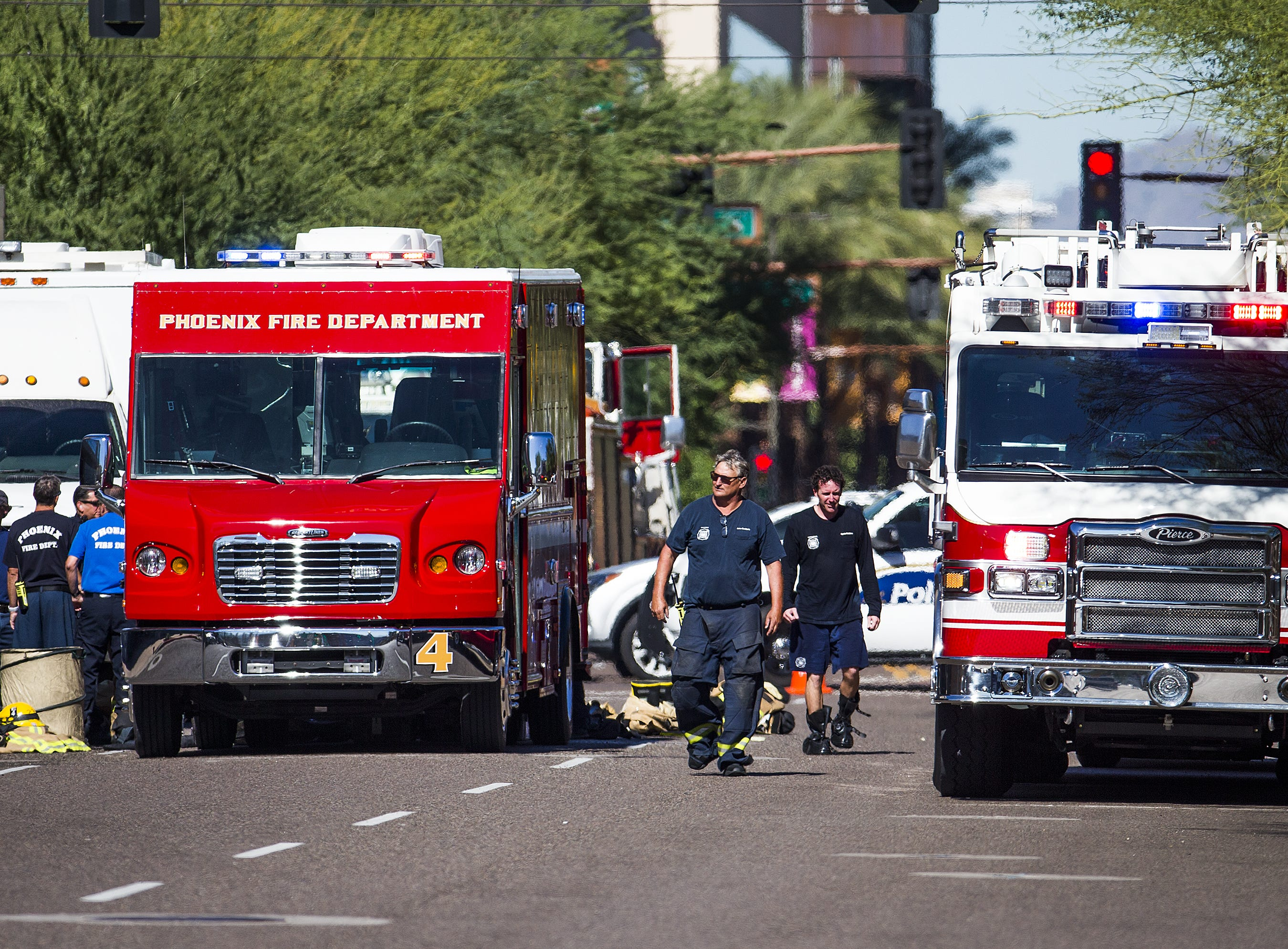 Phoenix firefighters and emergency personnel respond to reports of a white powder substance found in a downtown building, Friday, November 2, 2018. This view is looking north on 3rd Street at Washington.