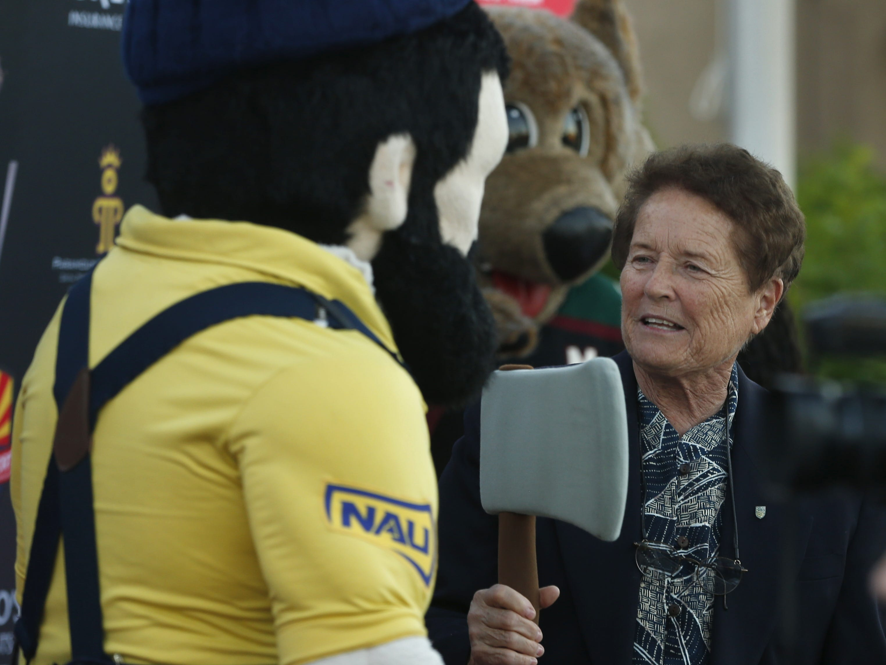Sister Lynn Winsor takes the axe of Louie the NAU Lumberjack before the Arizona Sports Hall of Fame induction ceremony at the Scottsdale Plaza Resort in Scottsdale, Ariz. on November 1, 2018.