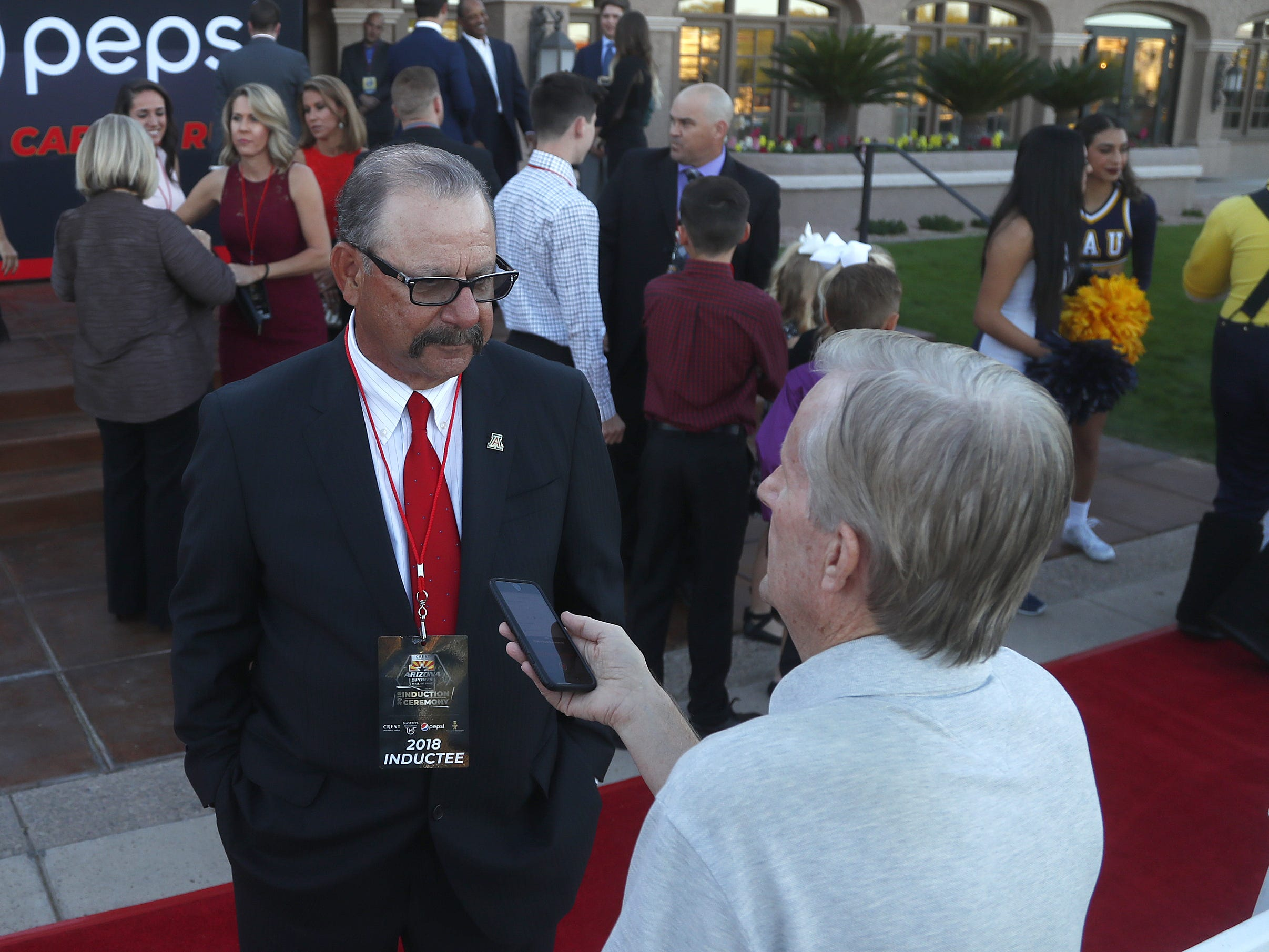Mike Candrea speaks with reporters before the Arizona Sports Hall of Fame induction ceremony at the Scottsdale Plaza Resort in Scottsdale, Ariz. on November 1, 2018.