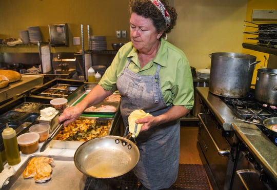 Chrysa Robertson works in the kitchen of her restaurant, Rancho Pinot, in Scottsdale, Tuesday, Oct. 16, 2018.