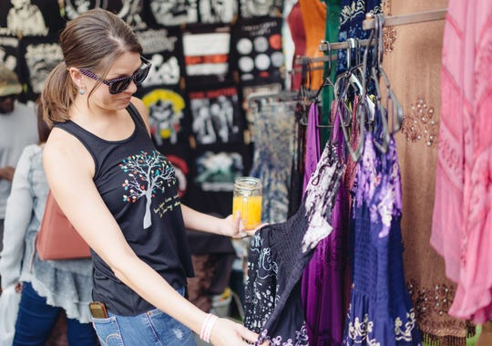 During the Arizona Fall Fest and Farmers Market, vendors sell handmade merchandise and food items.