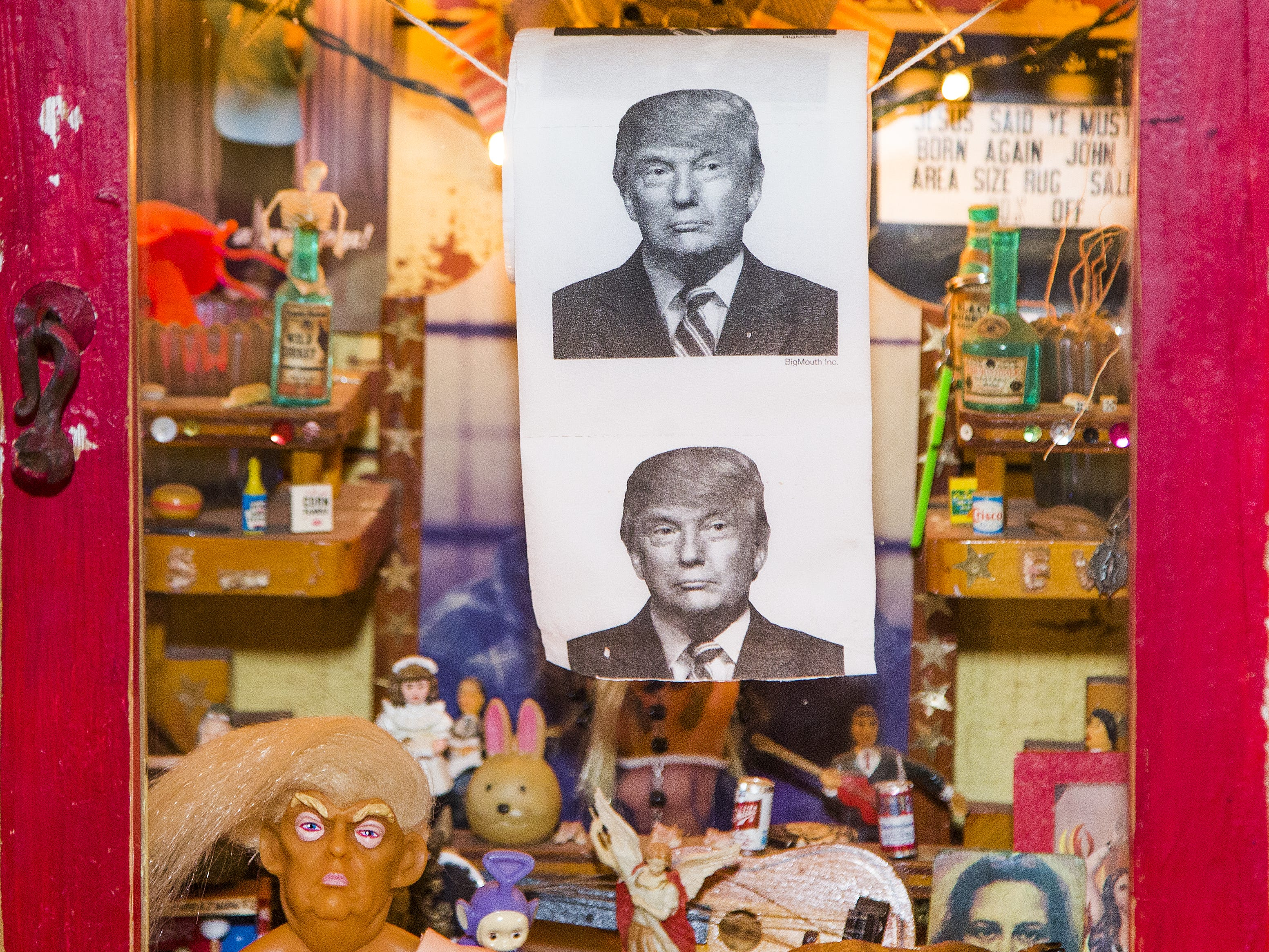 An interesting display case with religious, political and cultural artifacts stands against a wall at the restaurant Rancho Pinot, in Scottsdale, Tuesday, Oct. 16, 2018.