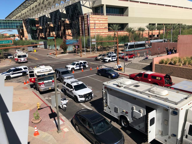 Fire trucks and police cars surround the Collier Center in downtown Phoenix on Nov. 2, 2018, where the 20th floor was evacuated because an envelope containing a mysterious, unidentified powder was discovered there.