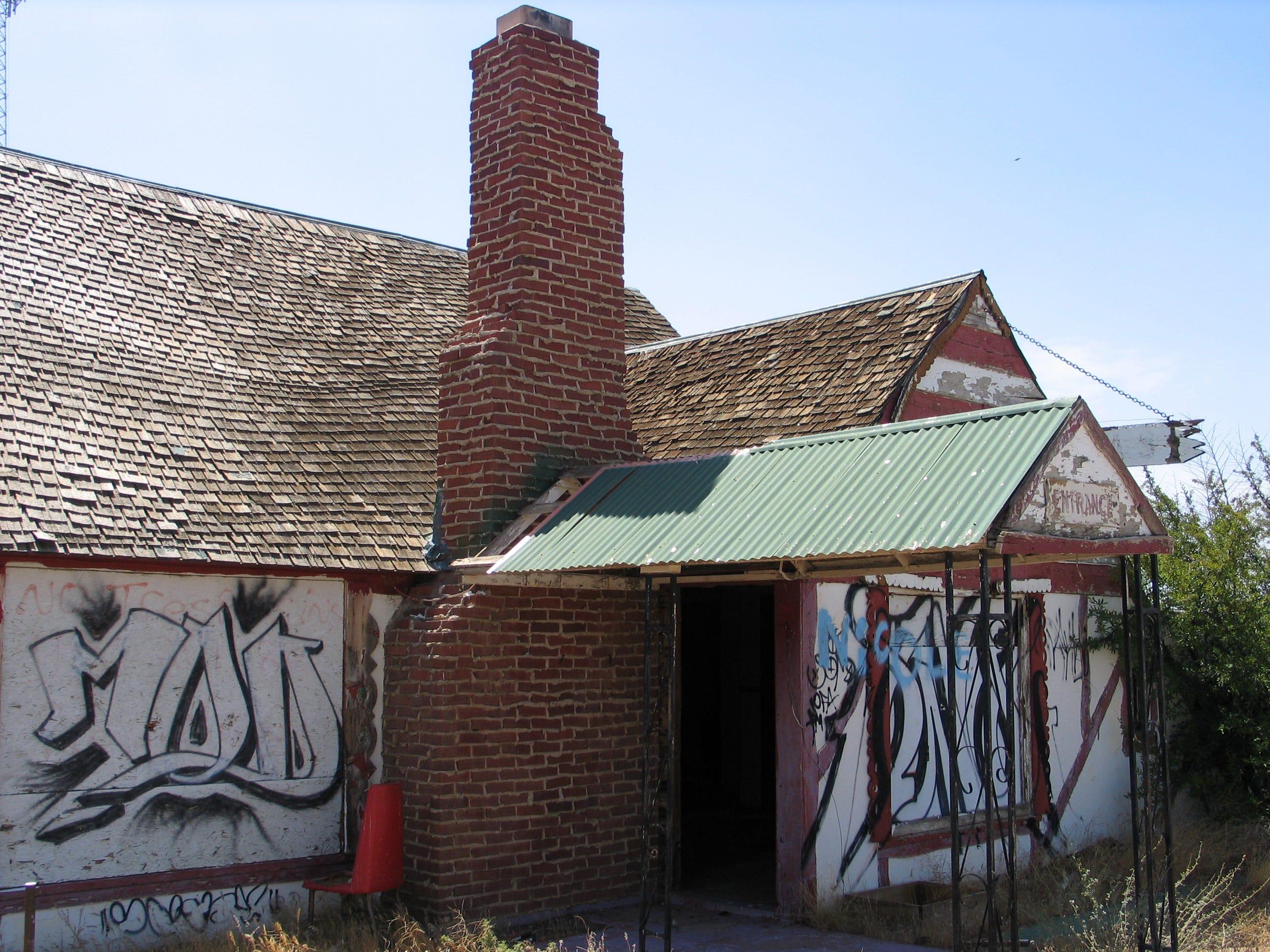 Graffiti covers the remains of Santa Claus, built along US 93 north of Kingman.
