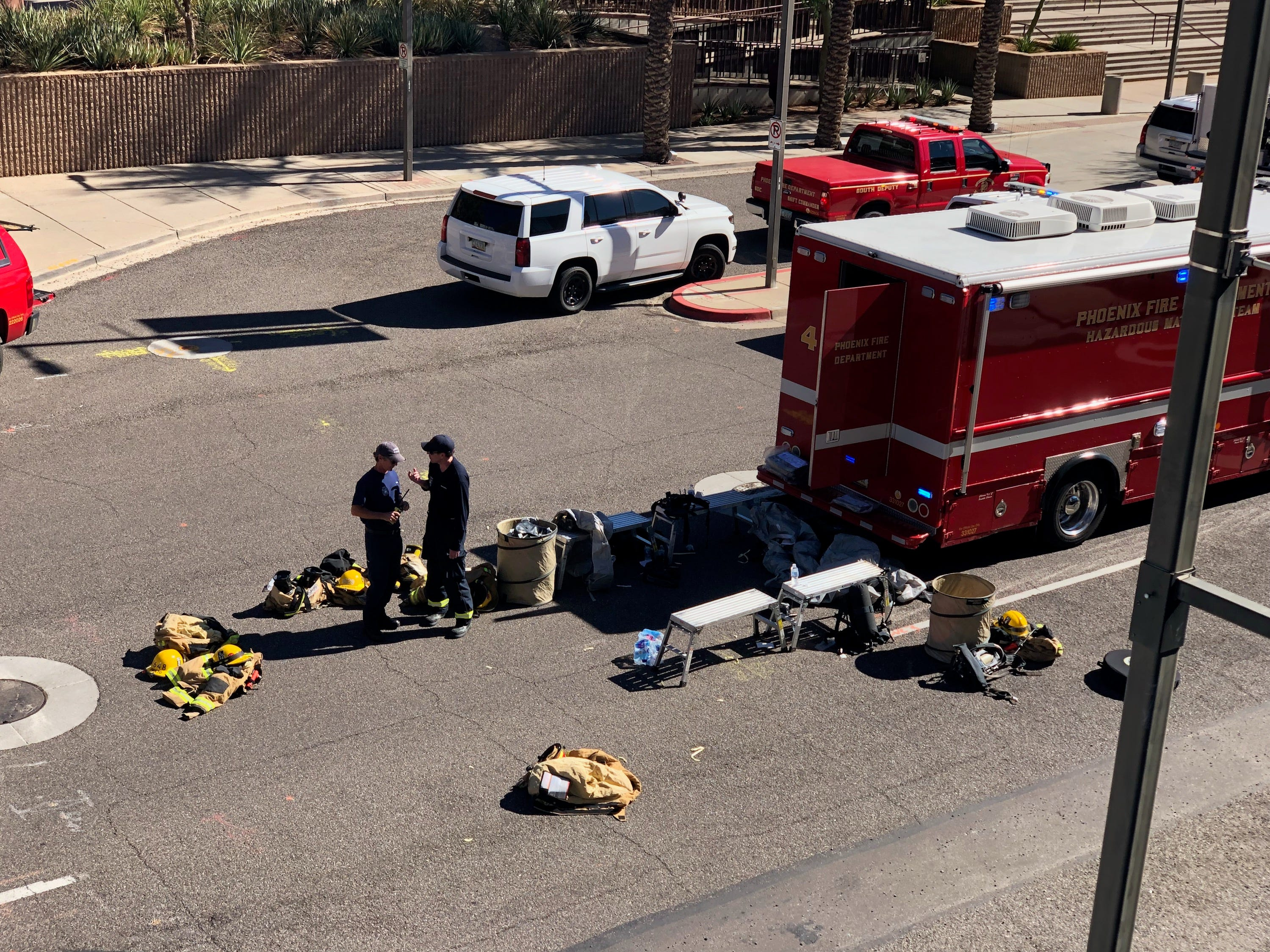 A Phoenix Fire Department vehicle sits parked by the Collier Center, 201 E. Washington St., on Nov. 2, 2018. The building's 20th floor was evacuated after the discovery of an envelope containing an unidentified white powder.