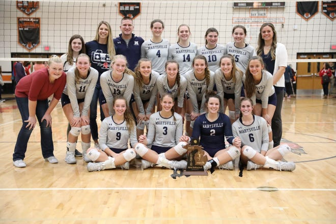 The Marysville High School volleyball team poses for a photo after winning a Division 2 district championship at Armada High School.