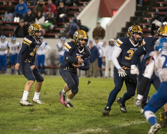 Port Huron Northern High School quarterback Seth Klink (10) hands off the football to running back Theo Ellis during their Division 2 finals match against St. Clair Shores Lakeview Friday, Nov. 2, 2018 at Memorial Stadium in Port Huron.