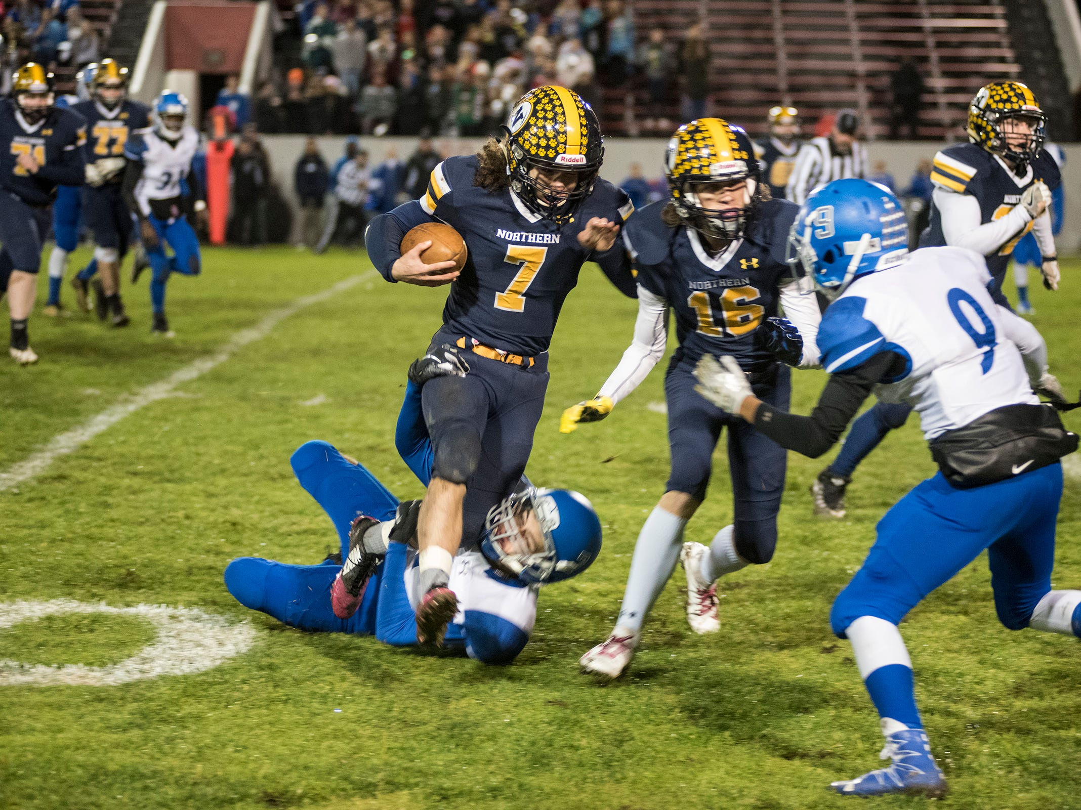 Port Huron Northern High School running back Theo Ellis (7) is tackled by St. Clair Shores Lakeview's Dante Hage during the first quarter of their Division 2 finals match Friday, Nov. 2, 2018 at Memorial Stadium in Port Huron.