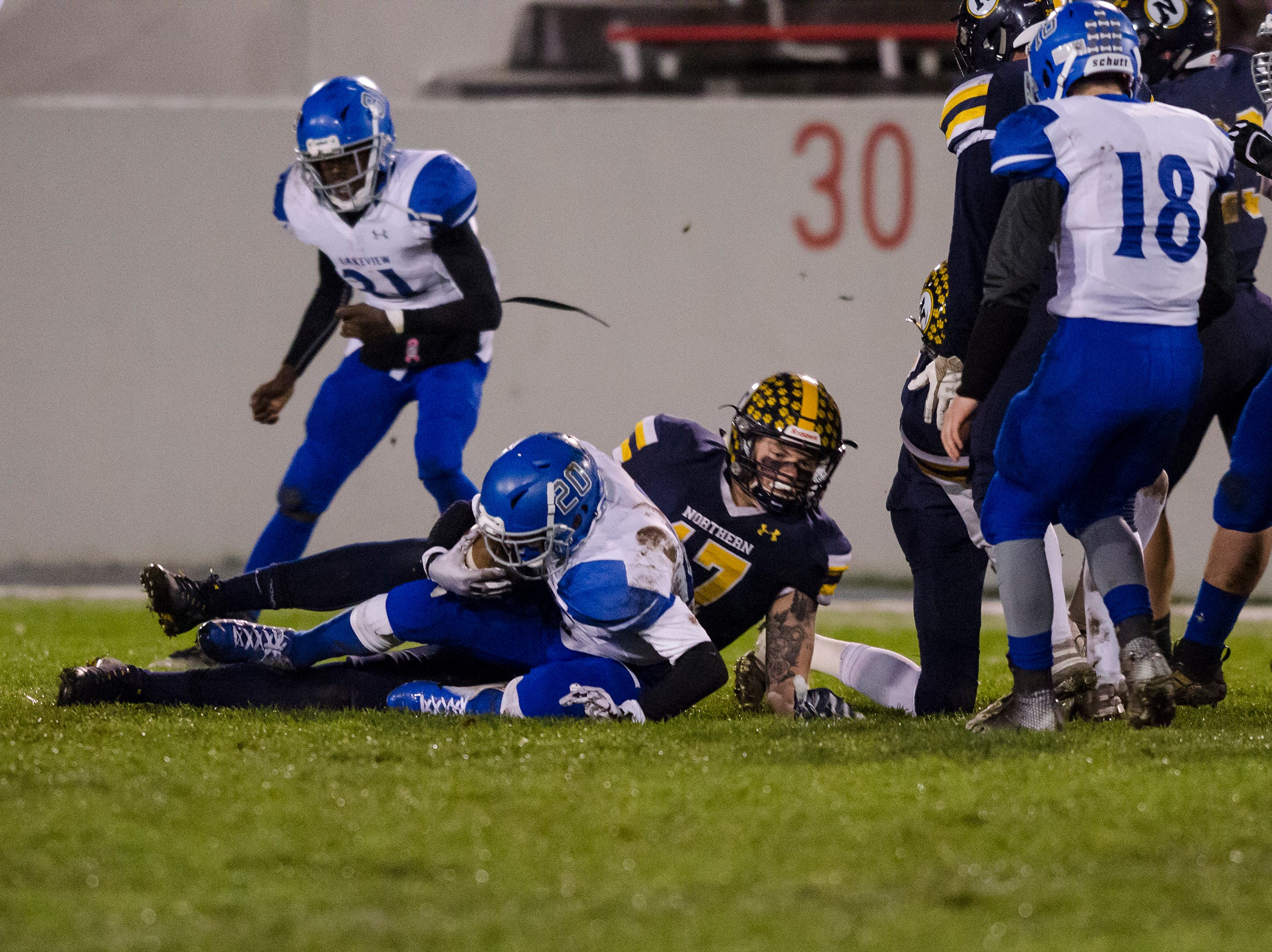 Port Huron Northern High School tight end Braiden McGregor (17) tackles St. Clair Shores Lakeview's Evan Rochon as he runs with the football in the first quarter of their Division 2 finals match Friday, Nov. 2, 2018 at Memorial Stadium in Port Huron.