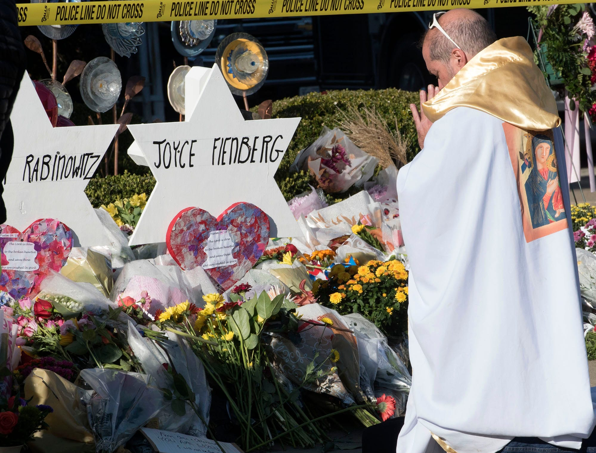 Brother Tomasio Vienditti, of St. Bernadette Catholic Church, Monroeville, Pa., prays at a memorial for victims on Tuesday, October 30, 2018. A gunman entered the Tree of Life Congregation Synagogue in the Squirrel Hill neighborhood of Pittsburgh and opened fire on the congregants and engaged police, Saturday morning, according to officials. (Markell DeLoatch, Public Opinion/via USA Today Network)