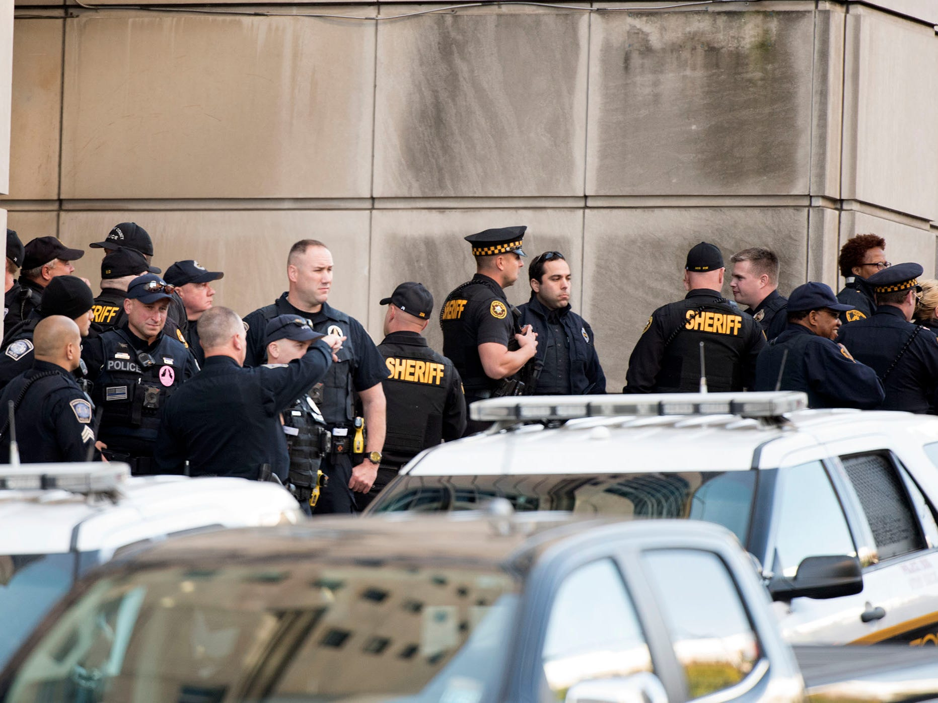 Pittsburgh area police wait at a UPMC entrance before President Trump's visit. A gunman entered the Tree of Life Congregation Synagogue in the Squirrel Hill neighborhood of Pittsburgh and opened fire on the congregants and engaged police, Saturday morning, according to officials. (Markell DeLoatch, Public Opinion/via USA Today Network)