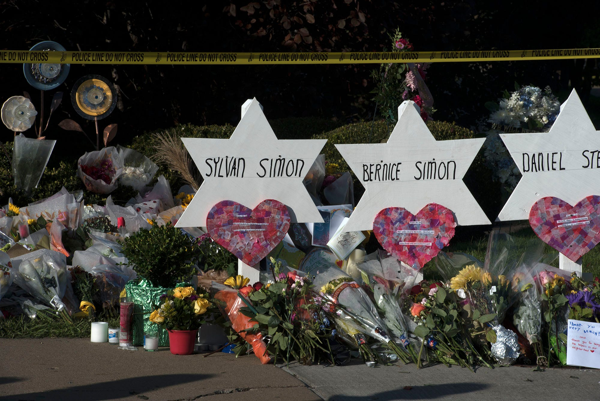 Mourners visited a memorial at a Pittsburgh neighborhood's synagogue. A gunman entered the Tree of Life Congregation Synagogue in the Squirrel Hill neighborhood of Pittsburgh and opened fire on the congregants and engaged police, Saturday morning, according to officials. (Markell DeLoatch, Public Opinion/via USA Today Network)