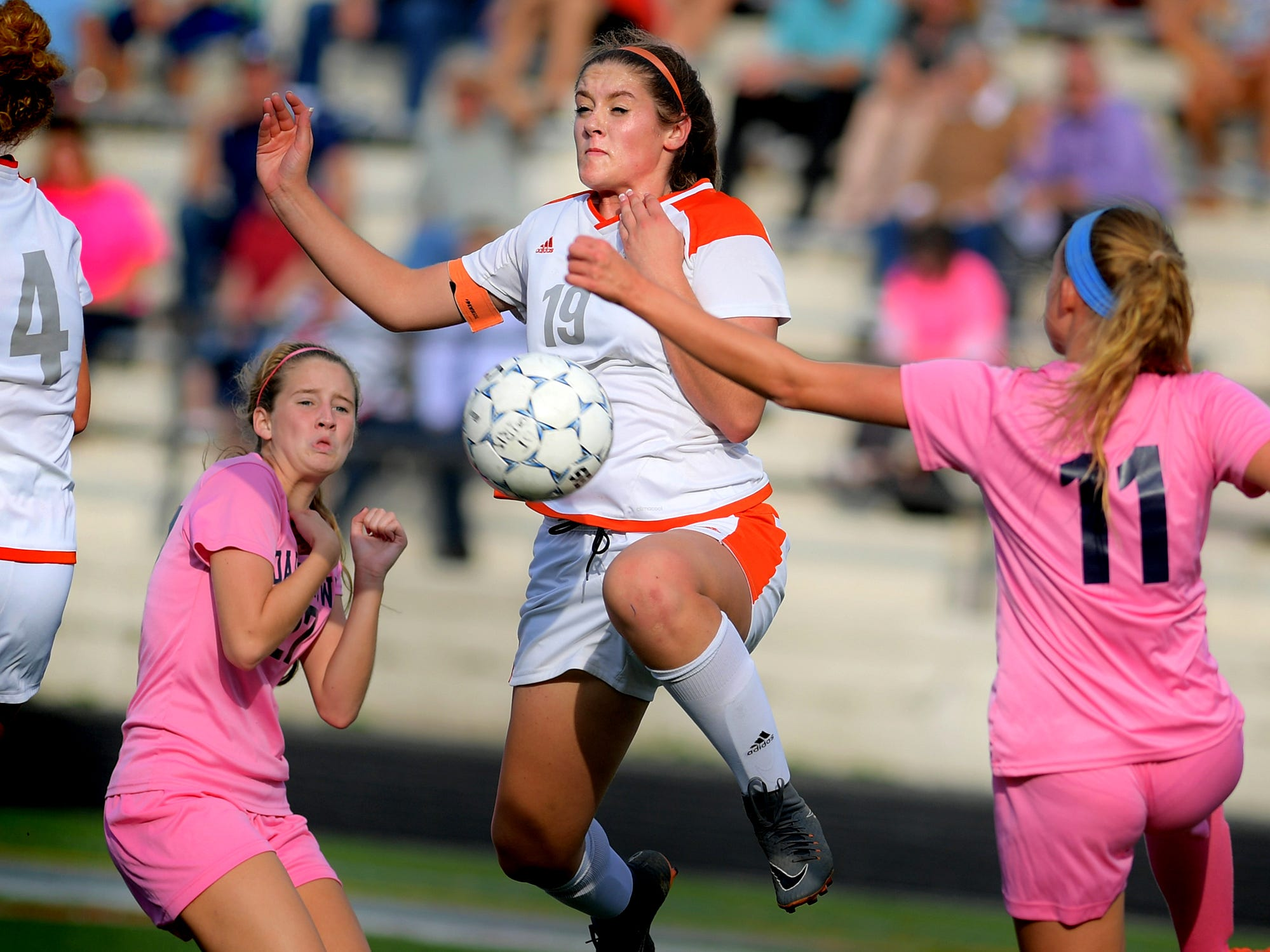 Central York's Hannah Ferguson takes control of a loose ball with Dallastown's Myra Streibig, left, and Lily Jamison (11) defending during action at Dallastown Tuesday, Oct. 9, 2018. Dallastown won 1-0. Bill Kalina photo
