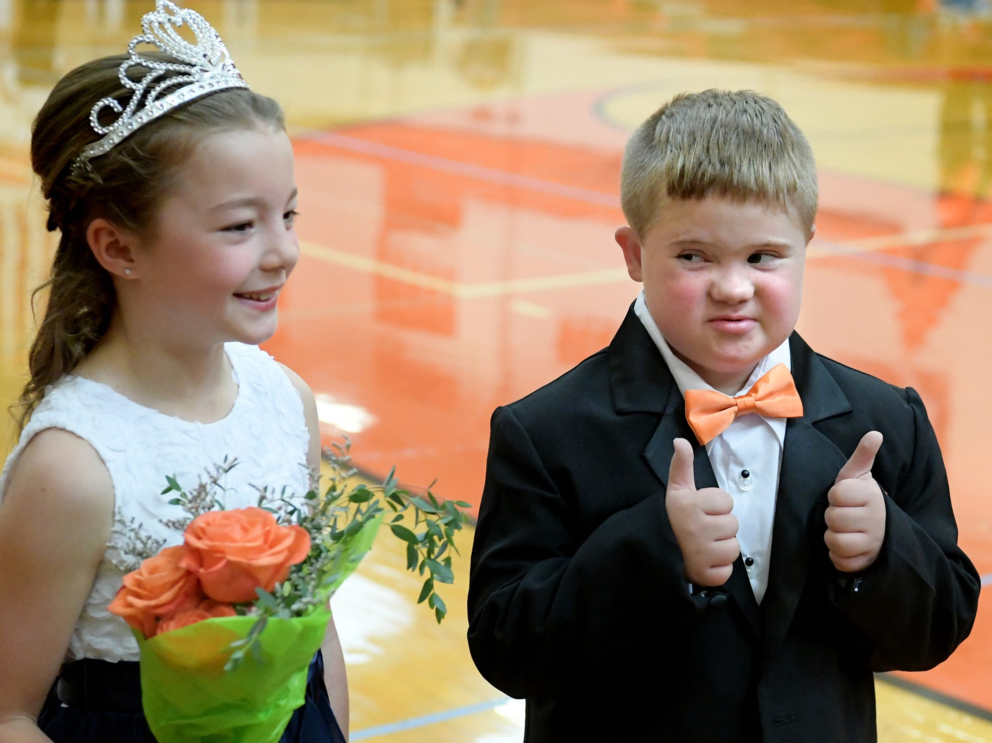 Homecoming prince Braydon Flynn, of Spring Garden Township, and princess, Keira Steinmetz, an Indian Rock Elementary third grader, both 8, prepare to be introduced at the York Suburban High School Homecoming pep rally Friday, Sept. 28, 2018. Braydon, who has Down Syndrome, is a Valley View Elementary second grader who participates in class with the help of a personal care assistant. The high school student council chooses the young court of princes and princesses from the district to appear in support of the high school's homecoming court. Bill Kalina photo