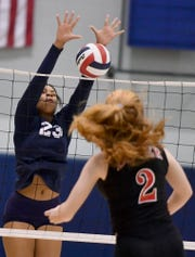Middle hitter Alayna Harris, seen here blocking a kill attempt last season, will return in 2019 for the West York girls' volleyball team.