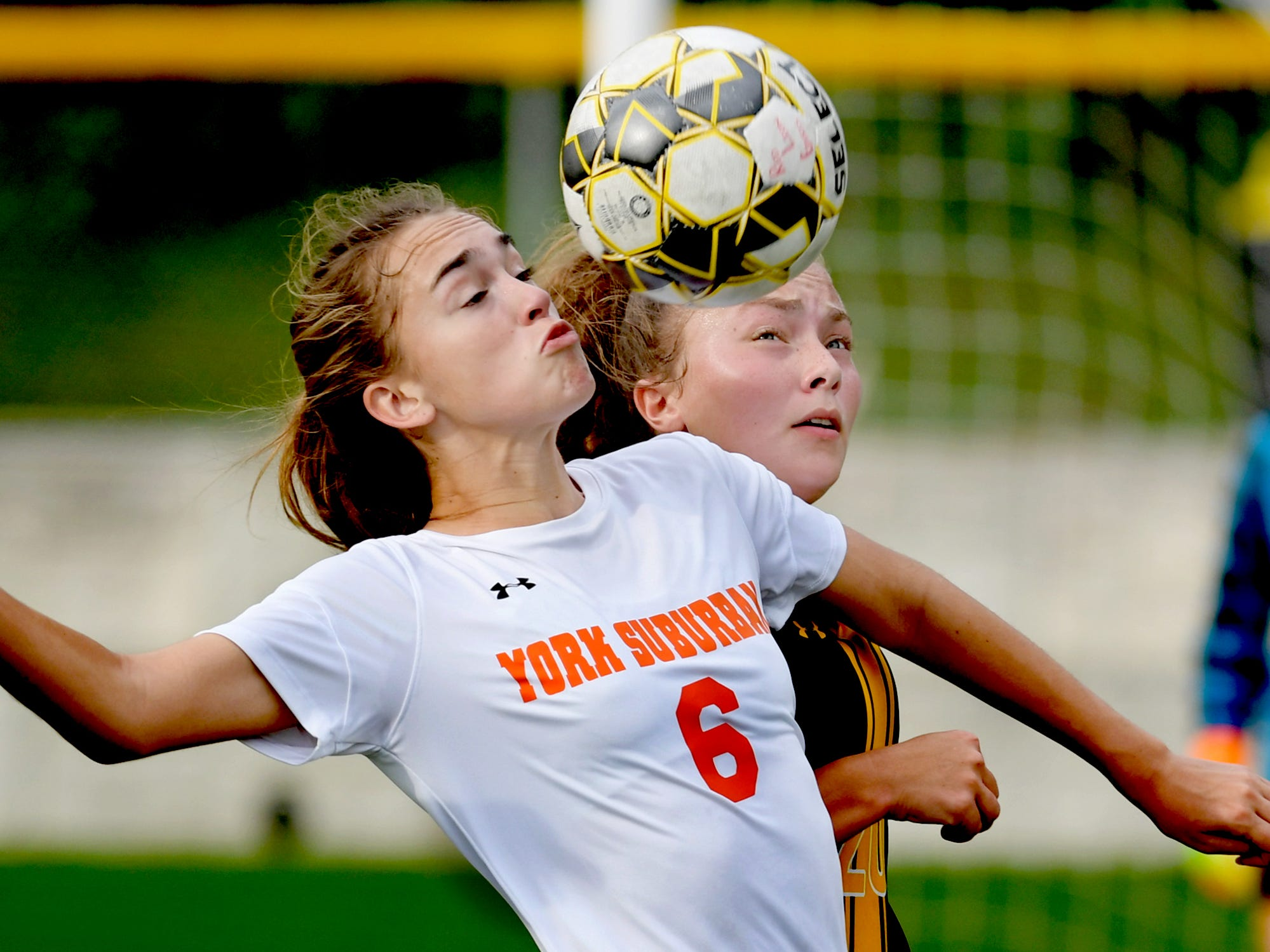 York Suburban's Hannah Drahusz and Red Lion's Shaye Robertson vie for possession during soccer action at Red Lion Tuesday, Oct. 2, 2018. Red Lion won 5-0. Bill Kalina photo