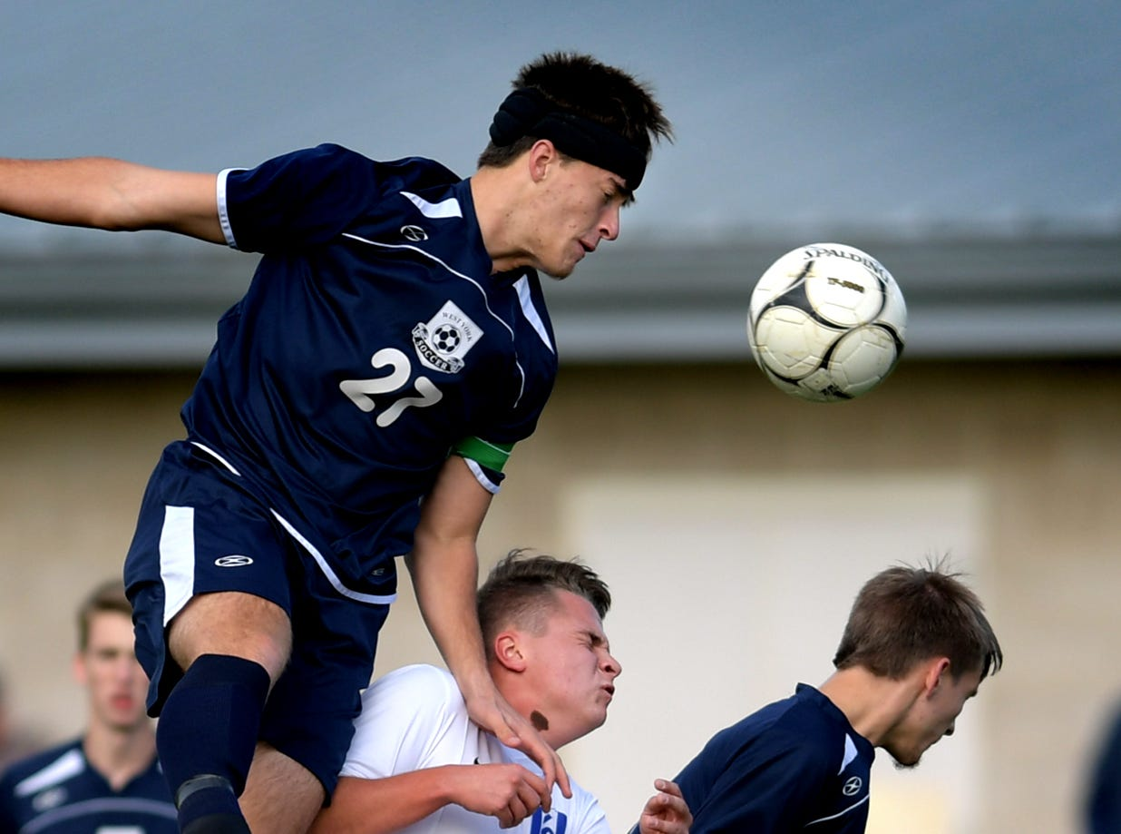 West York's Alex McClellan, left, heads the ball over Lampeter-Strasburg's Jared Rice and teammate Adam Hersey during a District 3 Class 3-A first-round boys' soccer match at West York Monday, Oct. 22, 2018. Bill Kalina photo