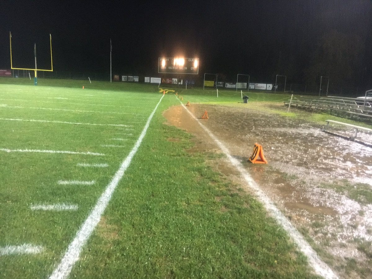 There isn't much grass for the coaches to stand on along this sideline at York Catholic.