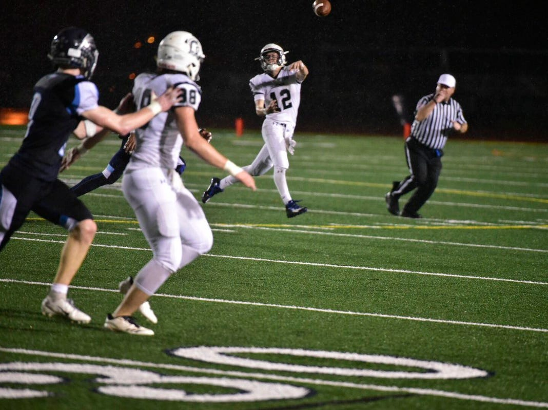 Chambersburg's Brady Stumbaugh tries to hit Taylor Carter with a pass Friday night.