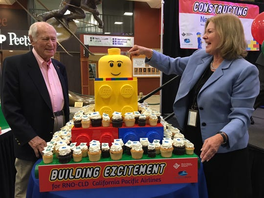 California Pacific Airlines CEO Ted Vallas and Reno-Tahoe International Airport President and CEO Marily Mora stand next to LEGO display with cupcakes on Nov. 2, 2018.