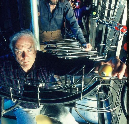 George Rhoads working on a ball machine sculpture.