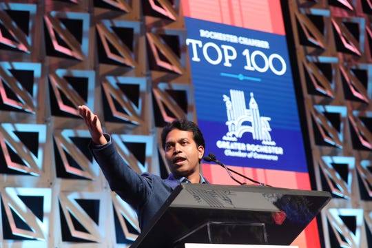 Sameer Penakalapati, president and CEO of Avani Technology Solutions Inc., this year's No. 1 company in the Top 100, addresses attendees at Thursday's banquet at the Joseph A. Floreano Rochester Riverside Convention Center.