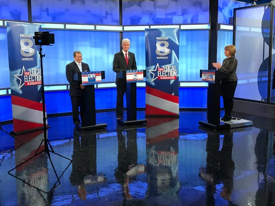Joseph Morelle, left, and Jim Maxwell, middle, open their second and final televised debate in New York's 25th Congressional District. It was hosted by WROC-TV (Channel 8) anchor Maureen McGuire, right.
