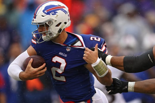 Buffalo Bills quarterback Nathan Peterman is sacked by Tavon Young of the Baltimore Ravens during the first quarter of the season opener at M&T Bank Stadium on Sep. 9, 2018.